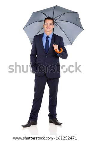 successful businessman in a suit holding umbrella on white background - stock photo