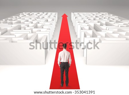 Successful businessman in front of a separated labyrinth, concept about simple solution - stock photo