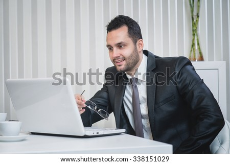 Successful businessman is happy with his internet sales. Office worker. Business partner. - stock photo