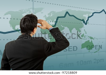 Successful businessman looking graph - stock photo