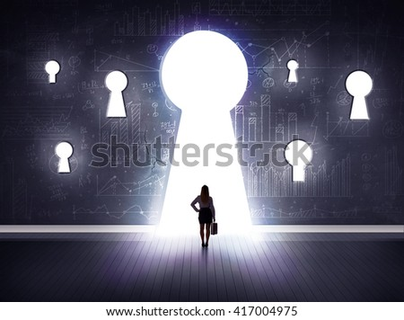 Successful businessman looking through keyhole - stock photo