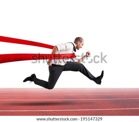 Successful businessman on the finishing line of a track - stock photo
