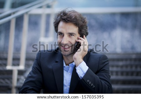 Successful Businessman on the phone at the office - stock photo