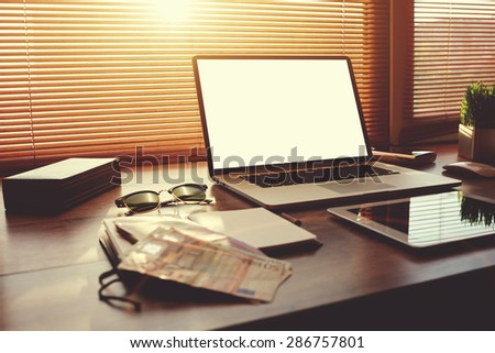 Successful businessman or entrepreneur table with style accessories,digital tablet and euro bills, open laptop computer with white blank copy space screen for text information or content, e-business - stock photo