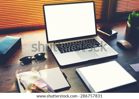 Successful businessman or entrepreneur table with style accessories, euro bills, open laptop computer and digital tablet with white blank copy space screen for text information or content, e-business - stock photo