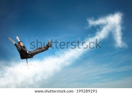 Successful businessman over a cloud like an arrow - stock photo