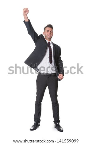 Successful businessman punches the air with joy - stock photo