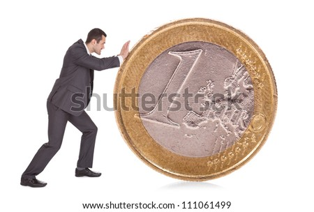 Successful businessman pushing one euro coin. Isolated on white - stock photo