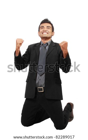 Successful businessman raise his hands, celebrating a win. Isolated on white - stock photo