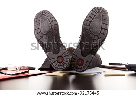 Successful businessman relaxing over desk, isolated in white background - stock photo