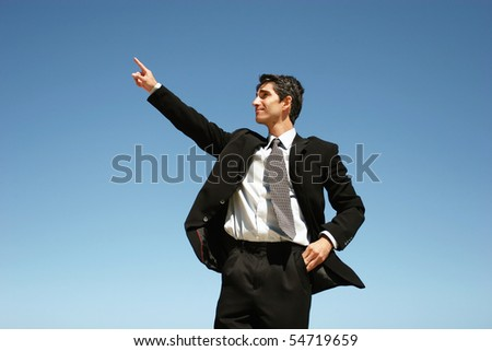 Successful businessman showing confidence - stock photo