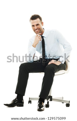 Successful businessman sitting on chair - stock photo