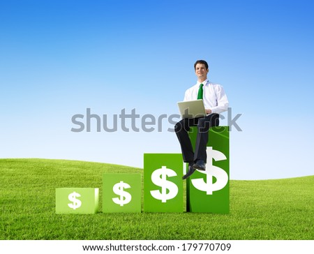 Successful Businessman Sitting with Laptop On Green Bar Graph Outdoors - stock photo