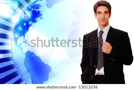 Successful businessman standing front of technology background - stock photo