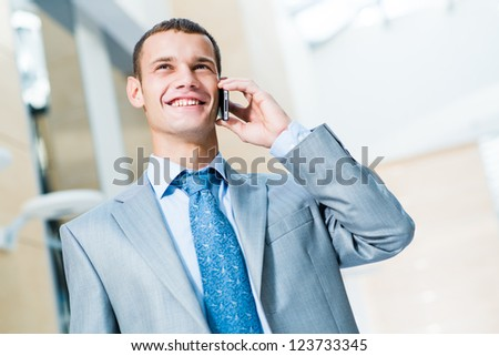 successful businessman talking on the phone and is happy to receive breaking news, to be successful in business - stock photo