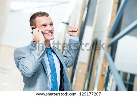 successful businessman talking on the phone and is happy to receive breaking news, to be successful in business