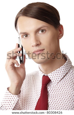 Successful businessman talking via cell phone on a white background - stock photo
