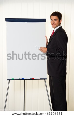 Successful businessman with a flip chart in a presentation - stock photo