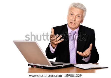 successful businessman with a laptop on a light background
