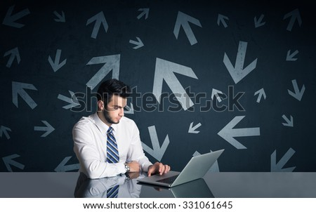 Successful businessman with arrows in background