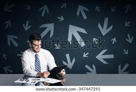 Successful businessman with arrows in background  - stock photo