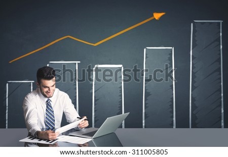 Successful businessman with business diagram in background  - stock photo