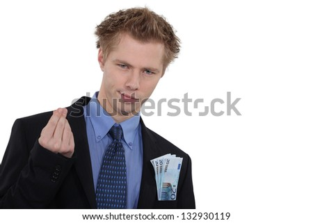 Successful businessman with cash - stock photo