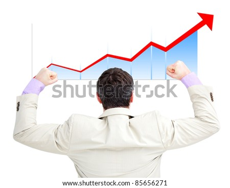 Successful businessman with the fists up looking at a growing curve - stock photo