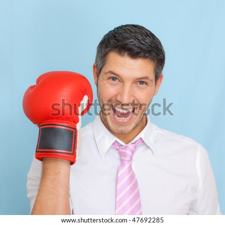 Successful businessman with tie portrait wearing boxing hand as concept of business career strength - stock photo
