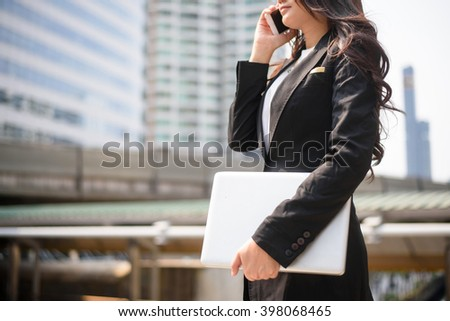 Successful businessman working at laptop in City - stock photo