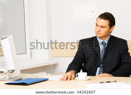 Successful businessman working at the computer in his office