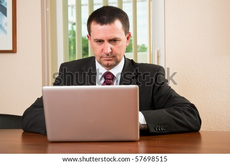 Successful businessman working on a laptop in the office