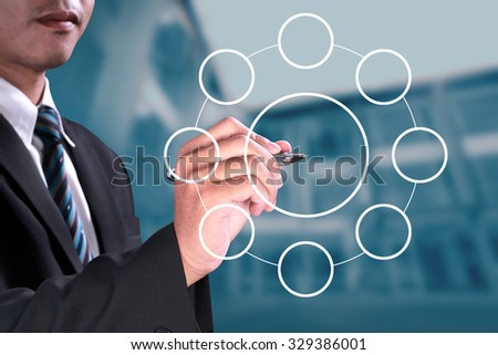 successful businessman writing blank circular diagram with magic pen on visual screen board over blue light modern office background - stock photo