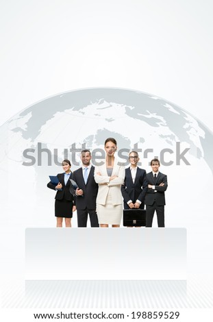 Successful businessmen standing in front of an earth map - stock photo