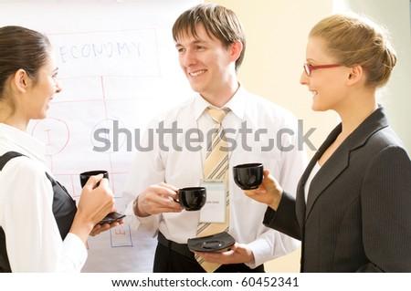 Successful businessmen talk at a seminar during a break - stock photo