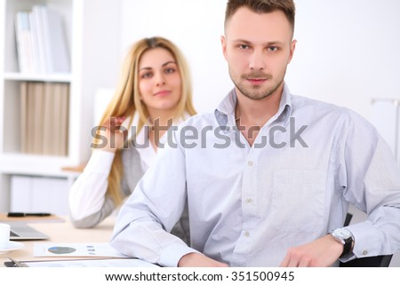 Successful businesspeople  working at meeting in office. Businessman looking at camera. Start up business concept. - stock photo