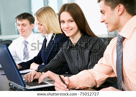 Successful businesswoman and colleagues working at office
