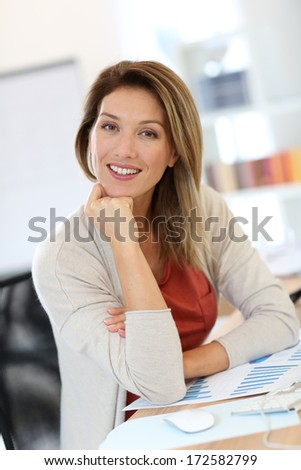Successful businesswoman at work - stock photo