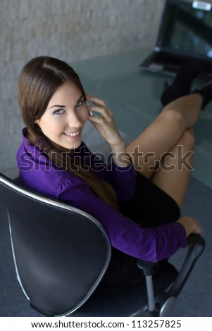Successful businesswoman calling legs up - stock photo