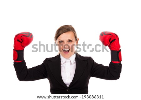 Successful  businesswoman celebrating wearing boxing gloves  isolated over white background