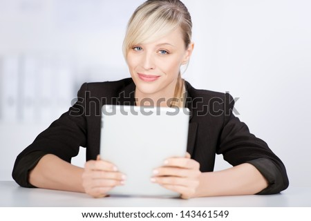 Successful businesswoman holding digital tablet in a close up shot