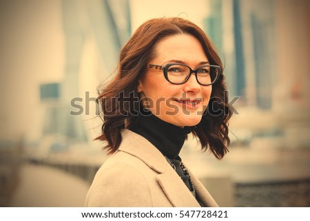 successful businesswoman in eyeglasses portrait, close up. instagram image filter retro style