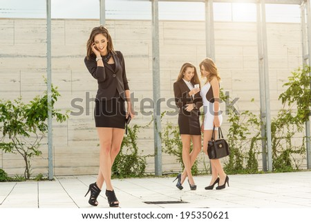 Successful businesswoman in the city  - stock photo