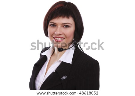 Successful businesswoman is speaking over the headset with a microphone. How can i help you? Face of young charming confident woman with headset.