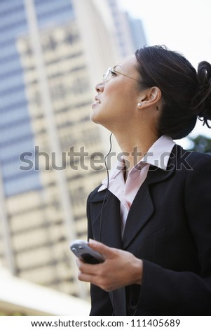 Successful businesswoman using cell phone