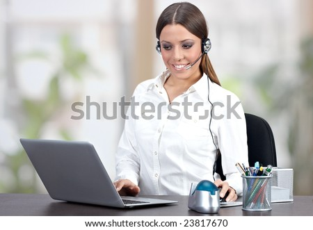 Successful businesswoman using laptop in office. - stock photo