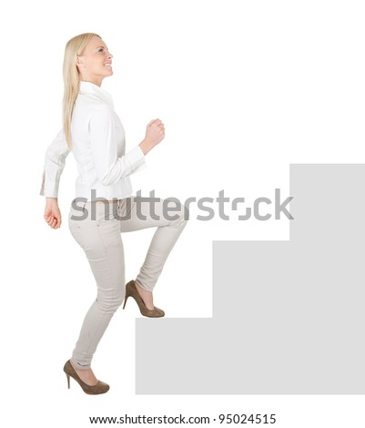 Successful businesswoman walking up a staircase - stock photo