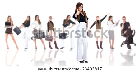 Successful businesswoman with business team in background (blurred). - stock photo