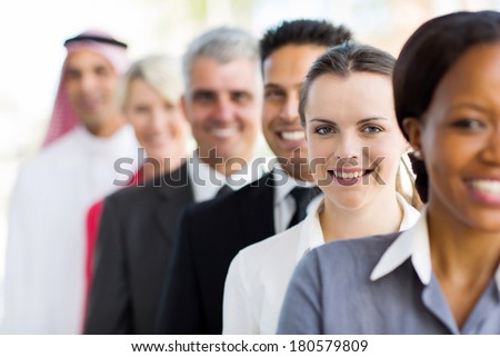 successful businesswoman with group of business people - stock photo