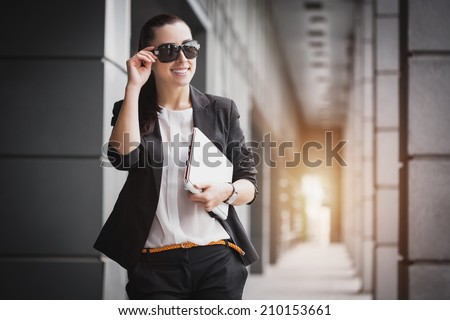 Successful Businesswoman with laptop. City businesswoman working. - stock photo
